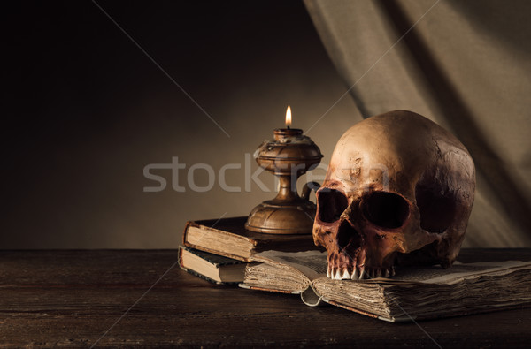 Human skull and ancient books still life Stock photo © stokkete