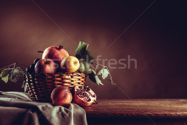 Fruit in a basket still life Stock photo © stokkete