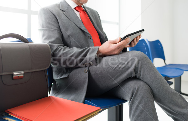 Businessman connecting with a tablet Stock photo © stokkete