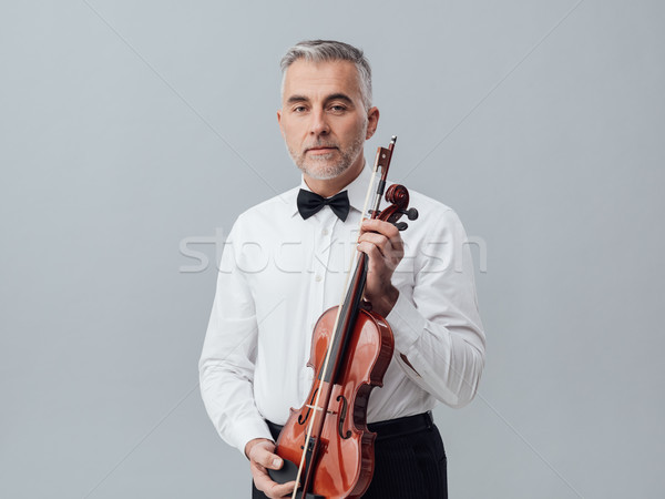 Violinist posing with his violin Stock photo © stokkete