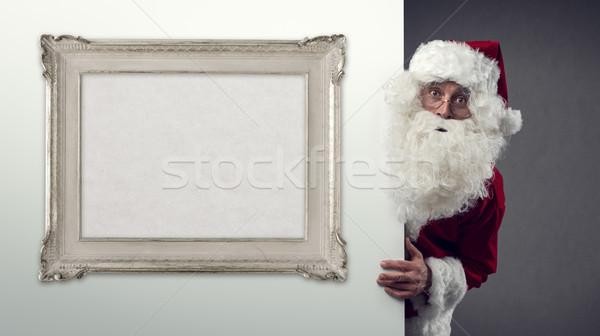 Papá noel decorativo marco detrás pared Navidad Foto stock © stokkete