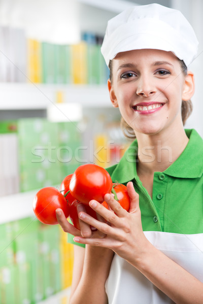 Sales clerk with fresh tomatoes Stock photo © stokkete