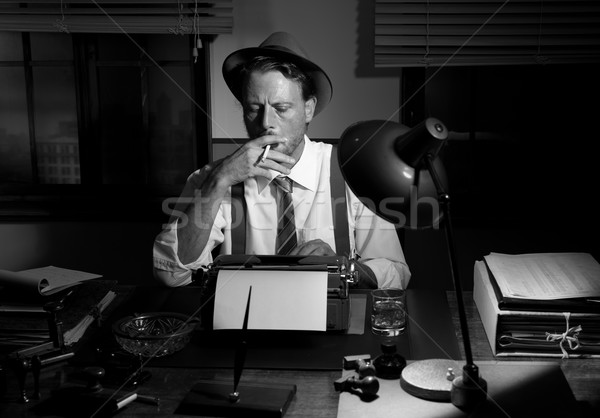 Retro reporter working late and smoking Stock photo © stokkete
