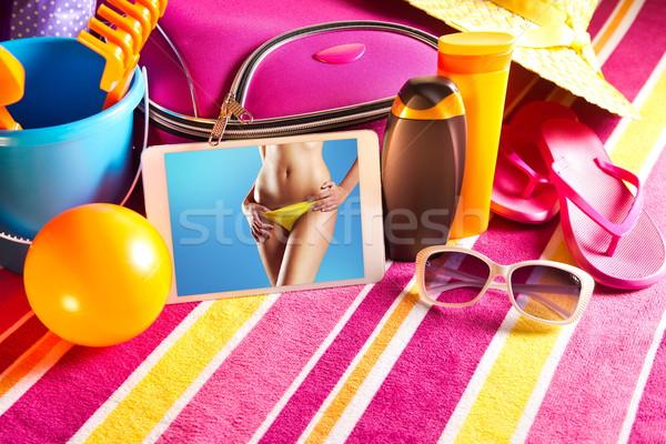 Vacanze immagini tablet vacanze asciugamano Foto d'archivio © stokkete