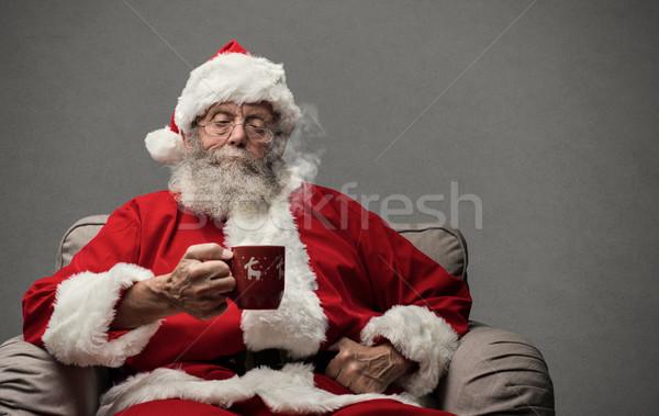 Kerstman warme drank ontspannen home fauteuil pak Stockfoto © stokkete