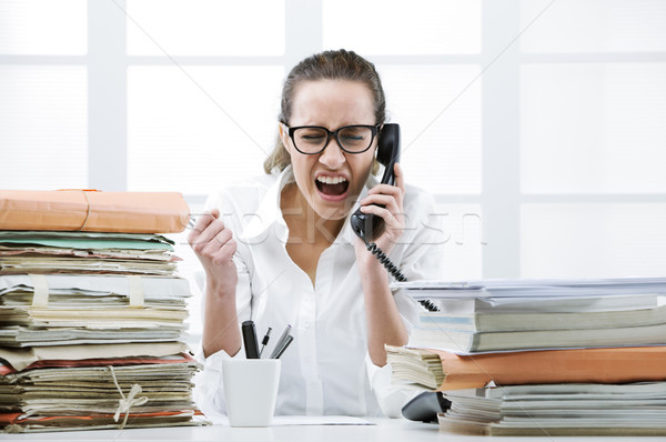 Angry Business woman Shouting At Phone Stock photo © stokkete