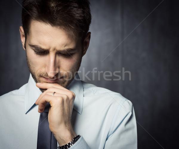 бизнесмен мышления молодые красивый стороны подбородок Сток-фото © stokkete
