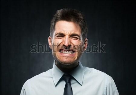 Boos jonge zakenman woedend donkere grijs Stockfoto © stokkete