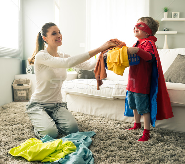 Little superhero helping his mother Stock photo © stokkete