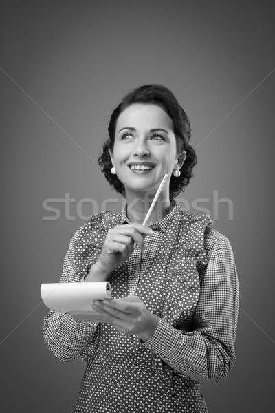 Housewife writing down a shopping list Stock photo © stokkete