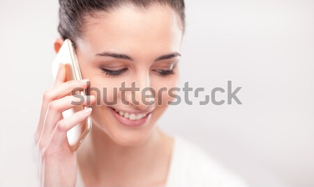 Pretty young woman having a phone call Stock photo © stokkete
