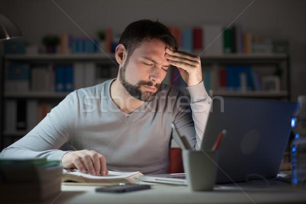 Sleepy young man with headache Stock photo © stokkete