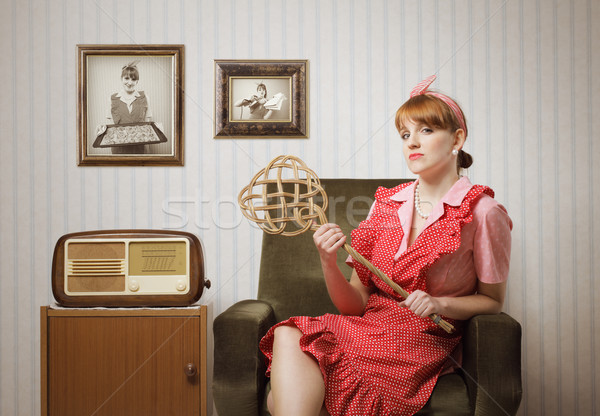 Ama de casa retrato irónico retro sesión sillón Foto stock © stokkete