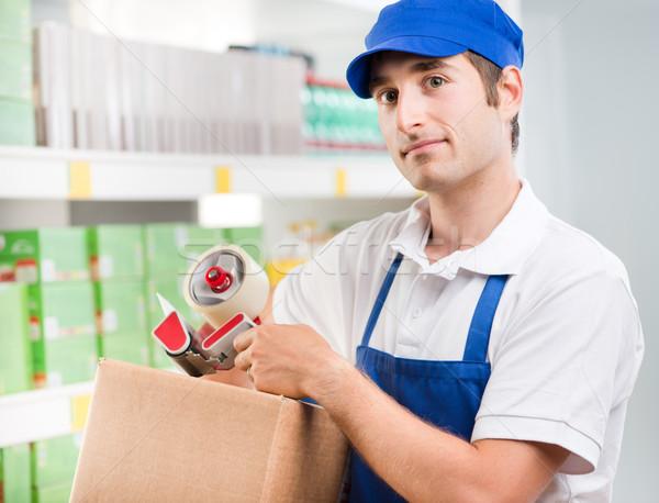 Sales clerk with cardboard box Stock photo © stokkete