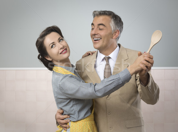 Vintage couple dancing in the kitchen Stock photo © stokkete
