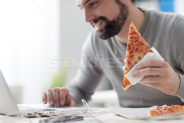 Man enjoying his lunch break Stock photo © stokkete