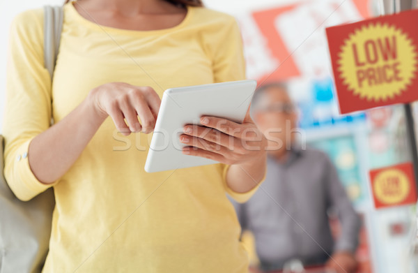 Woman shopping and using a tablet Stock photo © stokkete