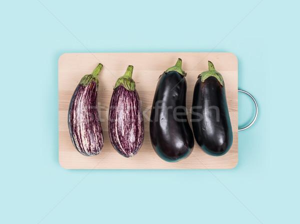 Fresh eggplants on a chopping board Stock photo © stokkete