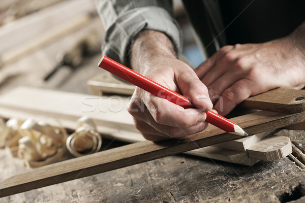 Carpenter Marking a Wooden Plank Stock fotó © stokkete