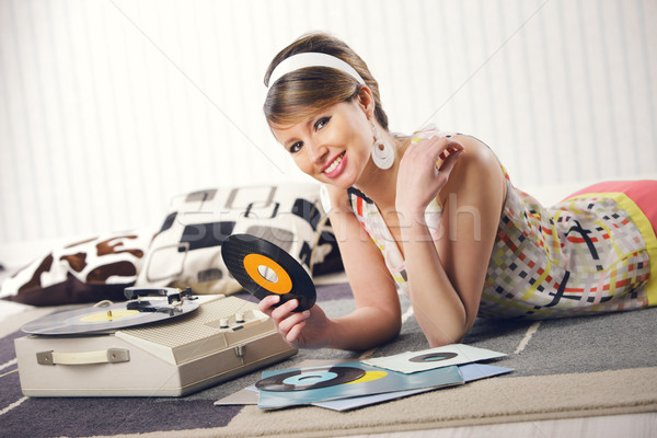 A woman listening to a record Stock photo © stokkete