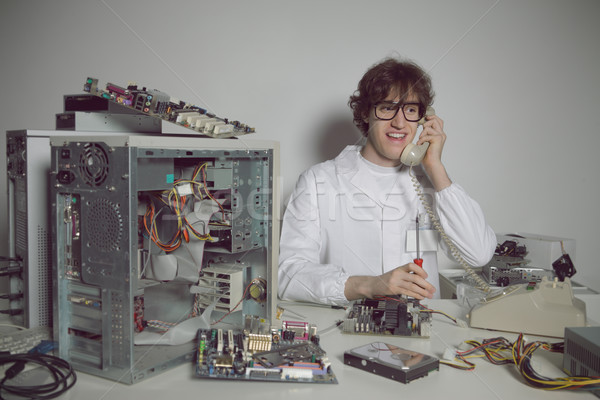 Reparação de computadores feliz computador técnico laboratório falante Foto stock © stokkete
