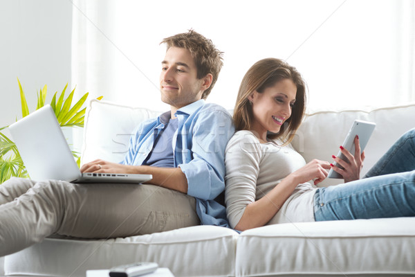 Couple surfing the net at home Stock photo © stokkete