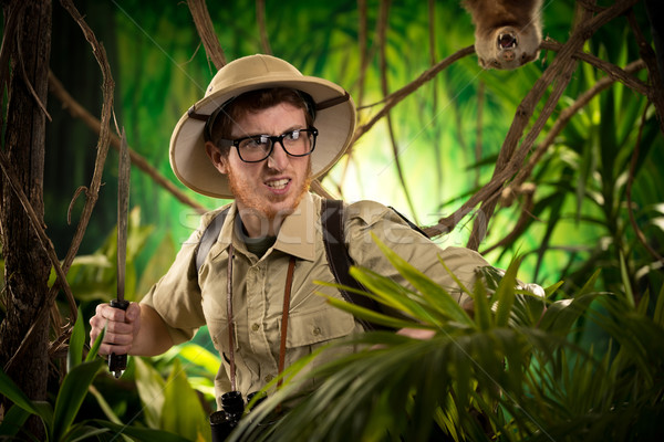 Aggressive adventurer exploring jungle Stock photo © stokkete