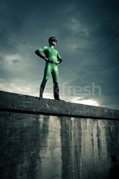 Confident superhero standing on a wall Stock photo © stokkete