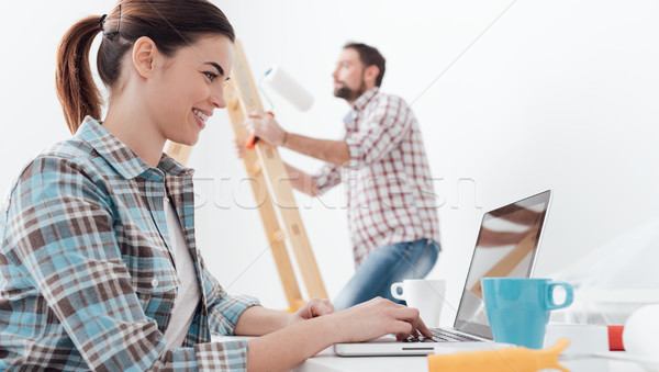 Happy couple remodeling their house Stock photo © stokkete