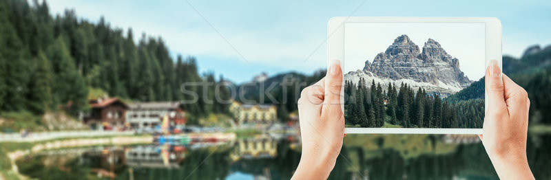 Tourist taking a picture of the Dolomites Stock photo © stokkete