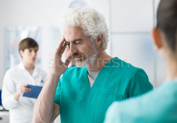 Healthcare worker having an headache Stock photo © stokkete