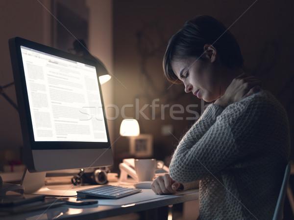 Kadın boyun ağrısı genç kadın çalışma bilgisayar Stok fotoğraf © stokkete