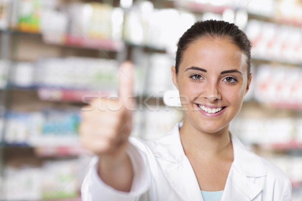 Portrait of Smiling Woman Pharmacist in Pharmacy Stock photo © stokkete