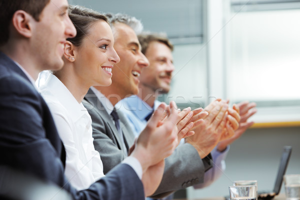 Clapping business people Stock photo © stokkete