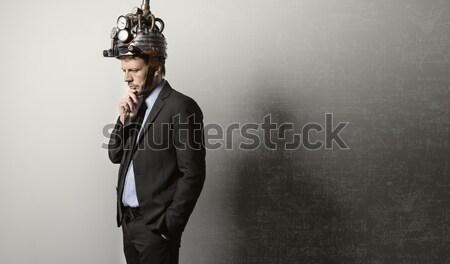 Businessman with steampunk helmet Stock photo © stokkete