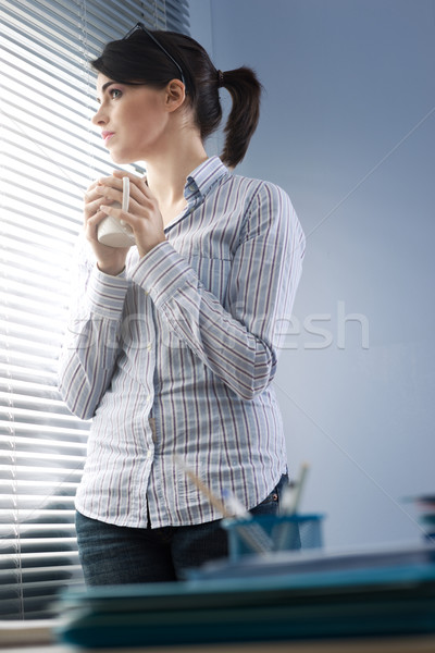 Peeking through blinds Stock photo © stokkete