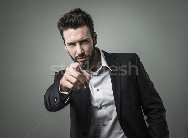 Confident businessman pointing Stock photo © stokkete