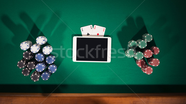 Online poker spel app digitale tablet Stockfoto © stokkete