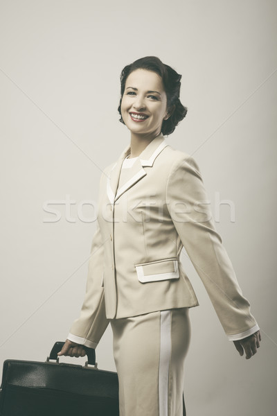 Cheerful vintage woman walking with briefcase Stock photo © stokkete