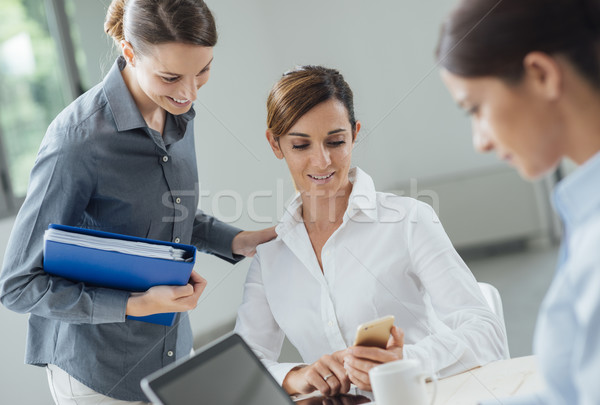 Female office workers in the office Stock photo © stokkete