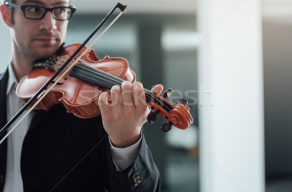 Talented violinist solo performance Stock photo © stokkete
