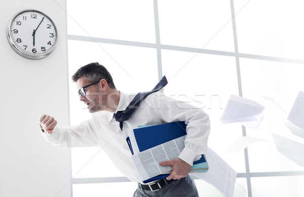 Businessman late for work Stock photo © stokkete