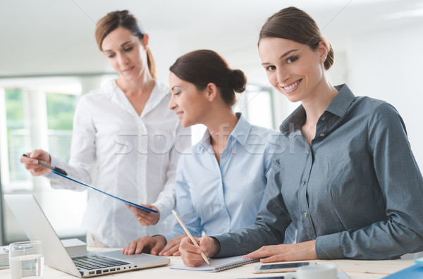 Business women team working at desk Stock photo © stokkete