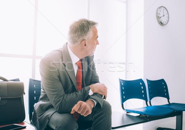 Sabırsız işadamı bekleme toplantı oturma Stok fotoğraf © stokkete