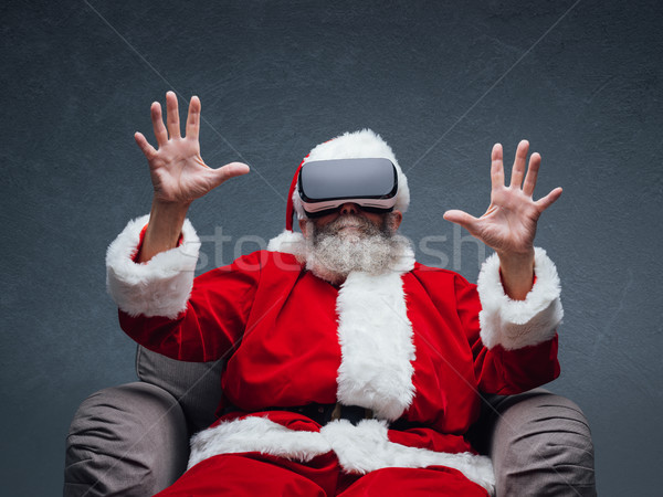 Santa Claus experiencing virtual reality Stock photo © stokkete