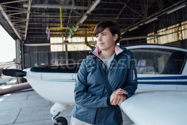 Pilot leaning on a light aircraft Stock photo © stokkete