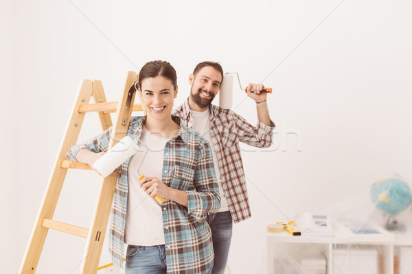 Happy couple painting their new home Stock photo © stokkete