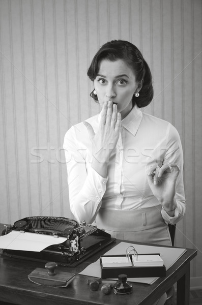 Retro office worker with surprised expression Stock photo © stokkete