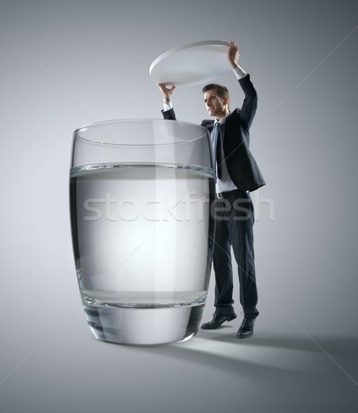 Egészségügy üzletember hatalmas tabletta üveg víz Stock fotó © stokkete