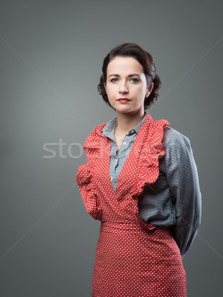 Vintage kobieta fartuch atrakcyjna kobieta stwarzające patrząc Zdjęcia stock © stokkete